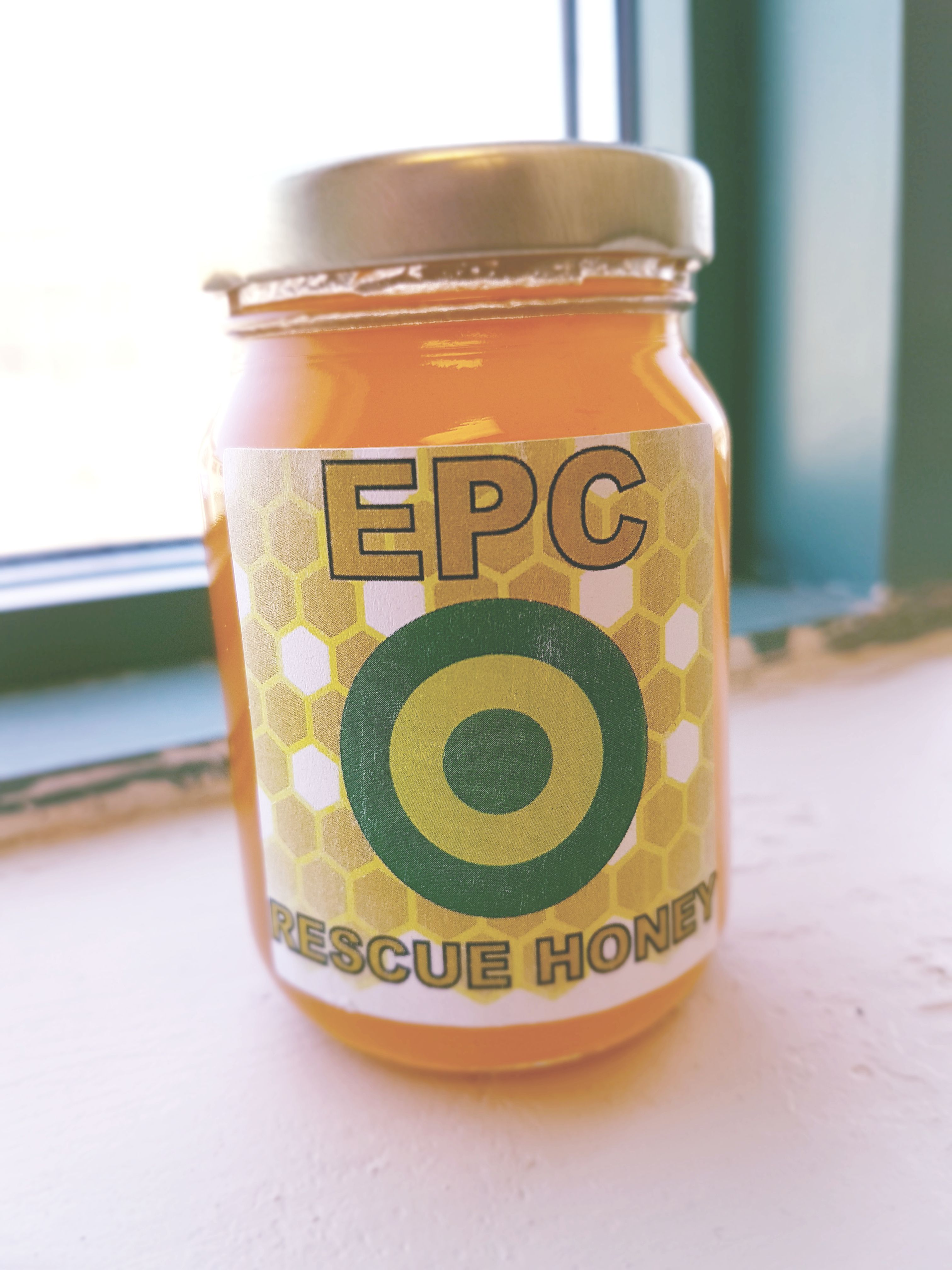 a jar of honey from environmental pest control