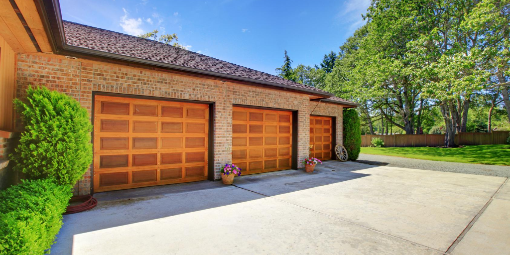 3 car garage exterior with nice wooden doors